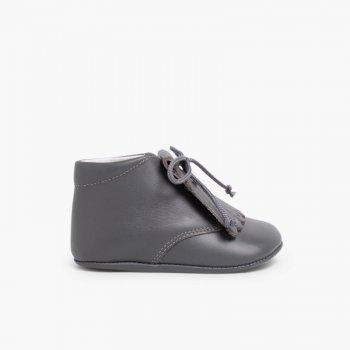 profesional mejor calificado online nueva llegada Zapatos para bebé en piel tipo botita con flecos